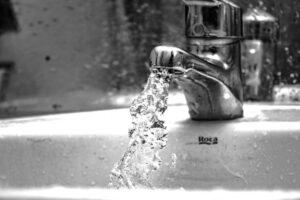 image of tap with splashing water